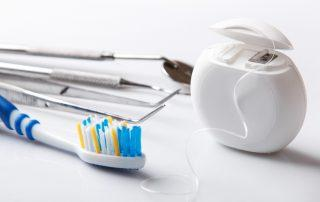 Close up of dental tools floss and toothbrush